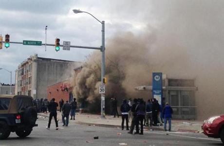 Smoke billowed from a CVS Pharmacy store in Baltimore on Monday.